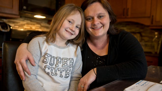 Beth Ambos of Jackson took her daughter Kaylee, 7, to CentraState Medical Center to have her injured foot treated. The hospital is in her insurance network, but the orthopedist in the emergency room was not, so Ambos got hit with a $3,251 bill for treatment.