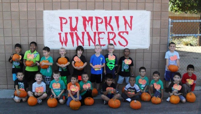 Students hold their winning pumpkins after racing in the VVES Pumpkin Run on Oct. 23.