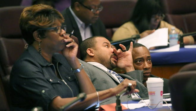 Aldermen Pat Dowell, third from left, Michael Scott Jr., and Gregory Mitchell, listen to testimony during committee hearings Tuesday, Oct. 4, 2016, at City Hall in Chicago. Budget and Public Safety committees met to discuss  the enactment of a Civilian Office of Police Accountability (COPA), the new police oversight committee.