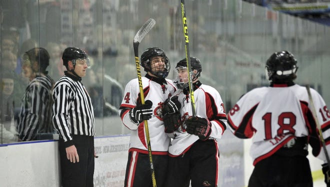 The Lakeland ice hockey team celebrates after winning a first round playoff game last winter. The two-time defending Passaic County Tournament champions return to the ice this weekend where they face Indians Hills in the season opener Saturday night in Wayne.