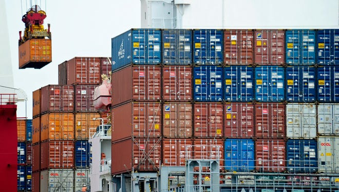 Goods being moved to ships from China. Tariffs imposed by a Trump administration would hit American consumers in the wallet.