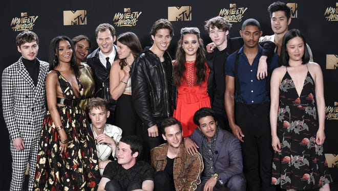"""The cast of """"13 Reasons Why"""" poses in the press room at the MTV Movie and TV Awards at the Shrine Auditorium on Sunday, May 7, 2017, in Los Angeles. Several local school districts have reached out to parents about the show."""