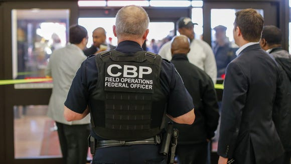 A Customs and Border Protection officer stands in the