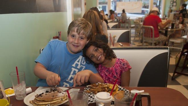 Nicolas Schwam-Piacquadio and Alexa Schwam enjoy dinner at the Pop Shop, a family favorite.