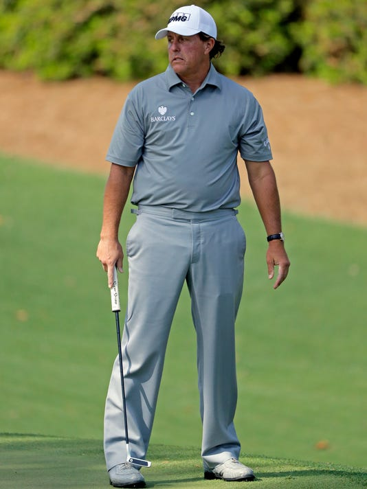 Phil Mickelson reacts after missing a putt on the 10th green during the second round of the Masters golf tournament Friday, April 8, 2016, in Augusta, Ga. (AP Photo/Jae C. Hong)