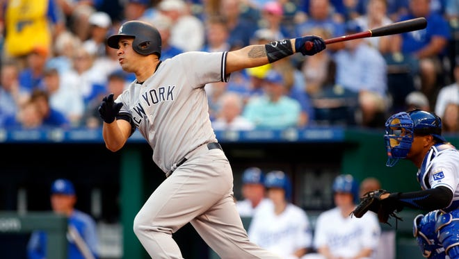 New York Yankees catcher Gary Sanchez (24) hits a single against the Kansas City Royals in the first inning at Kauffman Stadium.