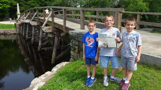 Zachary, Jacob, and Aaron Eckler of Union stand in front of Old North Bridge in Concord, Massachusetts.