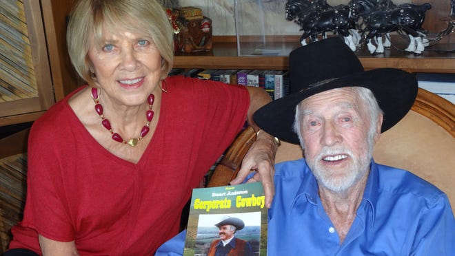 Restaurateur and author Stuart Anderson reminisces with wife Helen at a recent meeting held by Friends of the COD Library.