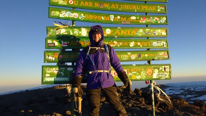 Duane Steil at the top of Mount Kilimanjaro.