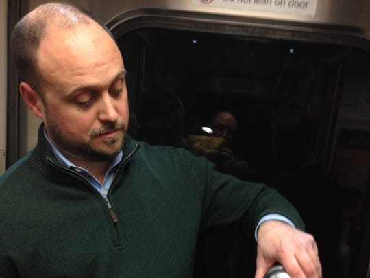 Luke Schnirring, 40, of Westport, Conn., pours himself and his friend mixed Manhattans on the 5:26 p.m. New Haven Line train from Grand Central Terminal, April 4, 2014.  The train used to feature a bar car, but they are about to be phased out completely, at least for now.