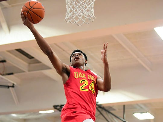 Apr 5, 2019; Middle Village, NY, USA; Oak Hill Warriors guard Cam Thomas (24) goes for a layup against the La Lumiere Lakers during the second quarter at Christ the King High School. Mandatory Credit: Catalina Fragoso-USA TODAY Sports ORG XMIT: USATSI-402834 ORIG FILE ID:  20190405_jcd_fa1_280.JPG
