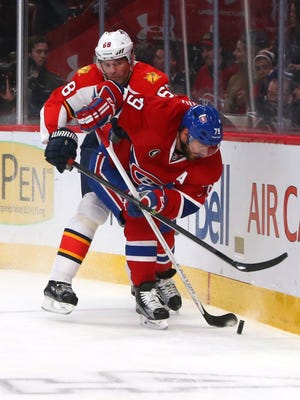 Florida Panthers right wing Jaromir Jagr (68) and Montreal Canadiens defenseman Andrei Markov (79) battle for the puck during the second period at Bell Centre.