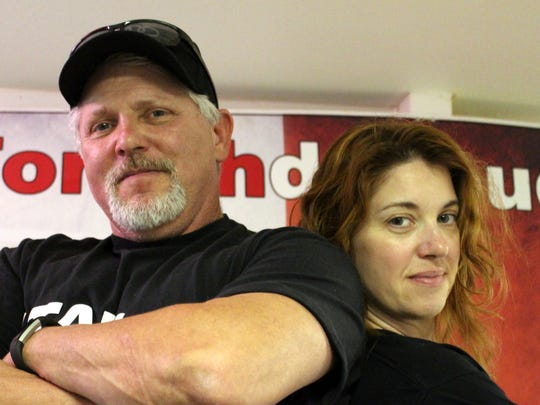 Bob and Kim Yacone, founders of Forghedaboudit Pizza in Deming, pose at the National Chicken Wing Festival in Buffalo, New York in 2016.