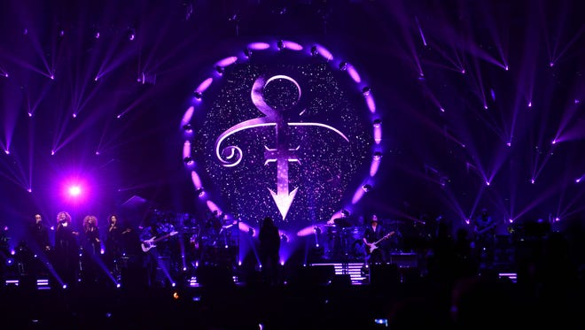 The symbol of late pop icon Prince shown as a tribute at concert by French singer Michel Polnareff in Epernay, eastern France, on April 30, 2016.