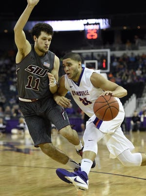 University of Evansville's D.J. Balentine looks for an opening in the defense while being guarded by Tyler Smithpeters of Southern Illinois during the first half of a game at the Ford Center in Evansville in 2016.  Balentine led all scorers with 27 points in the 83-71 victory.