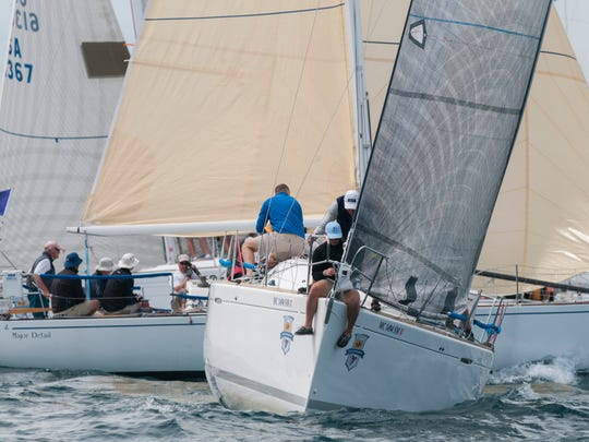 Grizzly, of Bayview Yacht Club, cuts back as Port Huron Yacht Club's Major Detail crosses behind it as they jockey for position at the starting line Saturday, July 16, 2016 during the start of the Port Huron-to-Mackinac Island Sailboat Race in the third race start that in included both Class G and Class H.