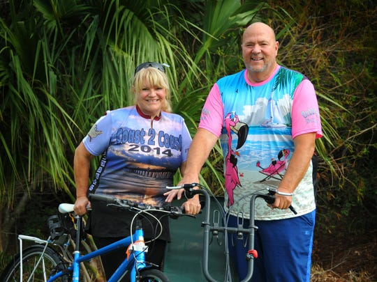 Bubba Barron of Viera, right, owner of Bubba's Pampered Pedalers, is working with assistant ride director Lil Leber of Cocoa on a Jan. 22-28 bicycle tour of the Space Coast.