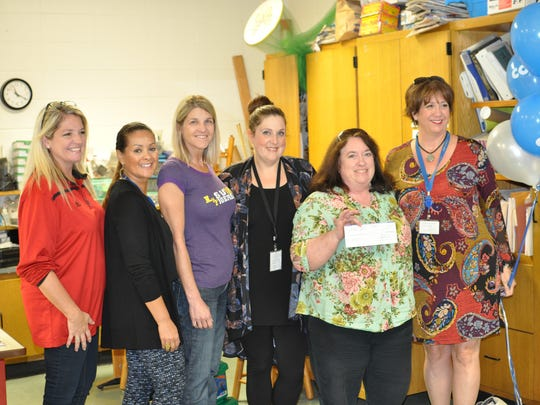 From left: Woodvale Assistant Principal Christy Hayes; Kelly Dugas, Cox Communications; Monique Vidos, principal, Woodvale Elementary; Patricia Thompson, Cox Communications; Susan Yerino, science teacher, Woodvale Elementary; Karmen Blanco, Cox Communications