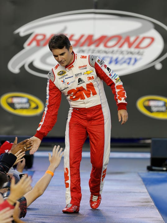 Jeff Gordon (24) greets fans during driver introductions before the NASCAR Sprint Cup auto race at Richmond International Raceway in Richmond, Va., Saturday, Sept. 12, 2015. (AP Photo/Steve Helber)