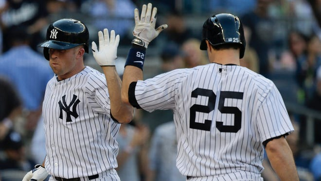 The' Yankees Brett Gardner, left, is congratulated by  Mark Teixeira after hitting a home run against the Pittsburgh Pirates during the sixth inning of Saturday's game.