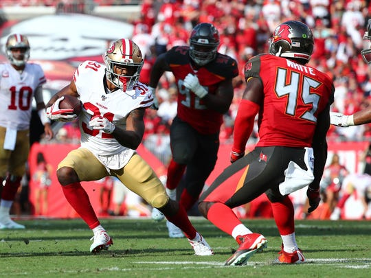 Sep 8, 2019; Tampa, FL, USA; San Francisco 49ers running back Raheem Mostert (31) runs with the ball as Tampa Bay Buccaneers linebacker Devin White (45) defends during the first half at Raymond James Stadium. Mandatory Credit: Kim Klement-USA TODAY Sports