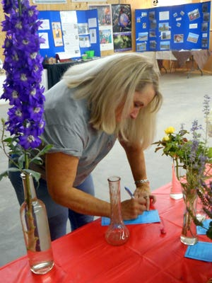 A participant registers her spectacular flower at the Lincoln County Fair.