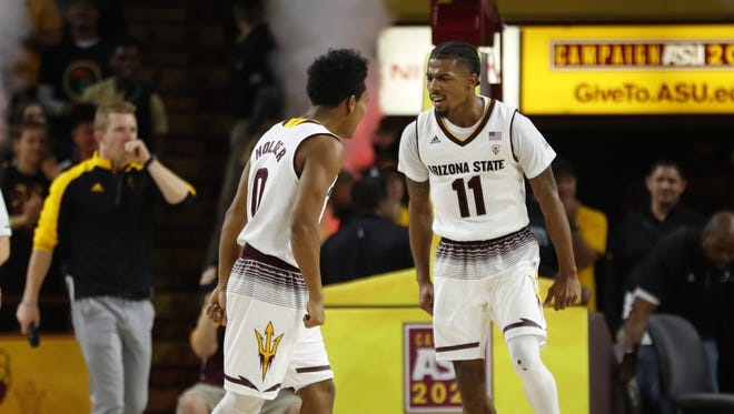 ASU's Tra Holder (0) and Shannon Evans II (11) celebrate a late lead against UCLA during second half at Wells Fargo Arena on February 10, 2018 in Tempe, Ariz.
