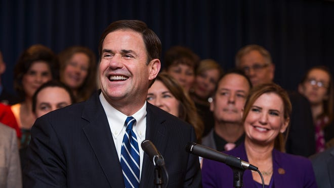 Gov. Doug Ducey announces a new package to increase compensation for teachers during a press conference at the Capitol in Phoenix on April 12, 2018.