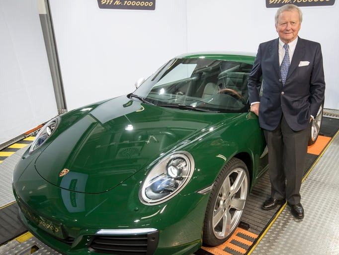 Wolfgang Porsche poses next to the 1-millionth Porsche