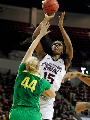 Mississippi State center Teaira McCowan (15) shoots at the basket over Oregon forward Mallory McGwire (44).