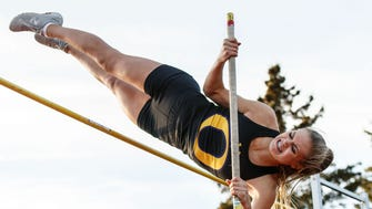 Oconomowoc senior Dana Hermann clears 11-00.00 to win the pole vault event during the Classic 8 Girls Conference Relays at Arrowhead on Monday, April 23, 2018.