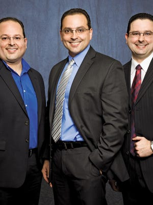 The Otero brothers, Carlos, left, Danny and Angel, are all professors at Florida Tech in Melbourne.