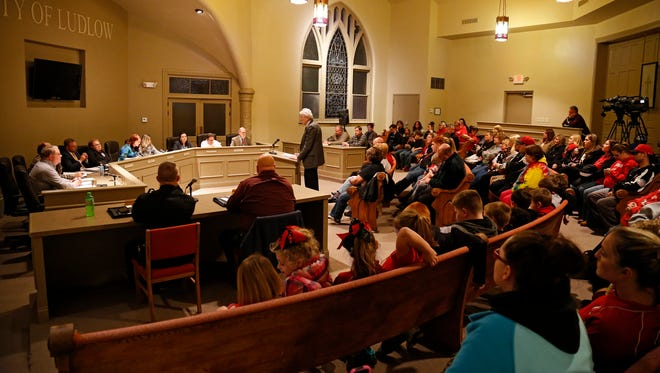 Attorney Phil Taliaferro speaks to Ludlow council about the resolution reached between the city and youth football league   as dozens of youth football supporters watch.