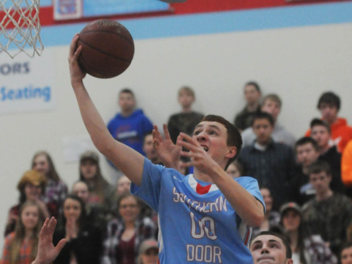 Southern Door's Trevor Hawkey drives past Wrightstown's Jacob Gilson during a Division 3 regional semifinal game in March. Hawkey averaged 11.9 points and a team-best 7.3 rebounds per game last season.