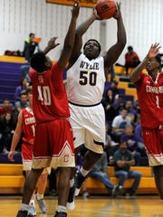 WylieÕs Dion Novil (50) puts up a shot over Lubbock Coronado's Cory Young (40) during the third quarter of the Bulldogs' 59-51 win on Saturday, Dec. 17, 2016, at Wylie High School.
