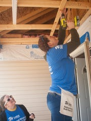 Habitat for Humanity volunteers, Marce Brozey, left, and Aimee Priest drill nails at a home in Gloucester County.  Habitat for Humanity  is building a house for a female veteran during National Women Build Week.