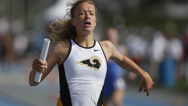 Southeast Polk's Brianna Hersom anchors her team in the first heat of the girls 4x100 meter relay Saturday.