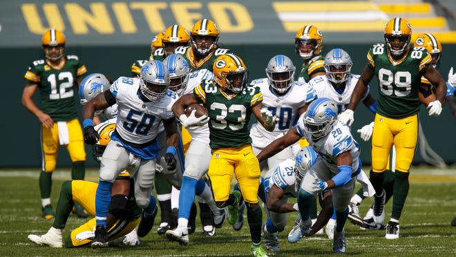 Green Bay Packers running  back Aaron Jones runs for a touchdown during the second half Sunday against the Detroit Lions in Green Bay, Wis.