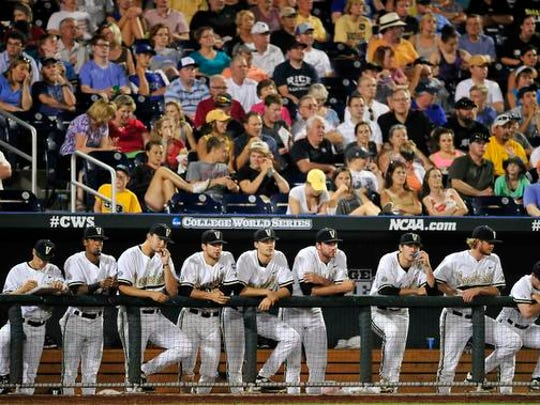 Vanderbilt players and fans are dejected after Virginia scores a run during the 7th inning in the last game of the College World Series at TD Ameritrade Park, Wednesday, June 24, 2015, in Omaha, Neb.