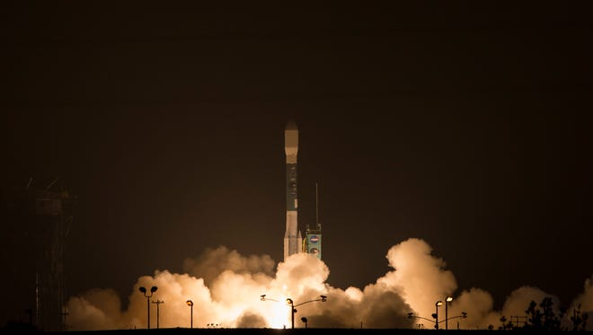 This photo provided by NASA, A Delta 2 rocket carrying the Soil Moisture Active Passive, SMAP, satellite launches early Saturday, Jan. 31, 2015.