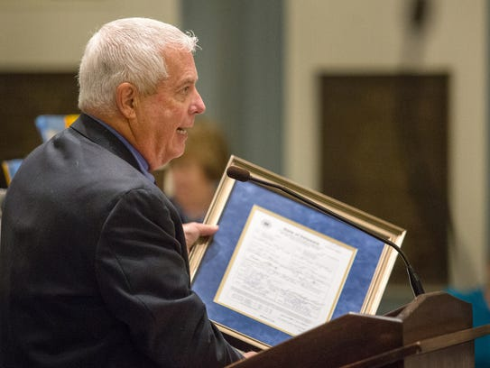New Castle County Clerk of the Peace Ken Boulden holds up the marriage license during a 2014 special session of the Delaware Senate.