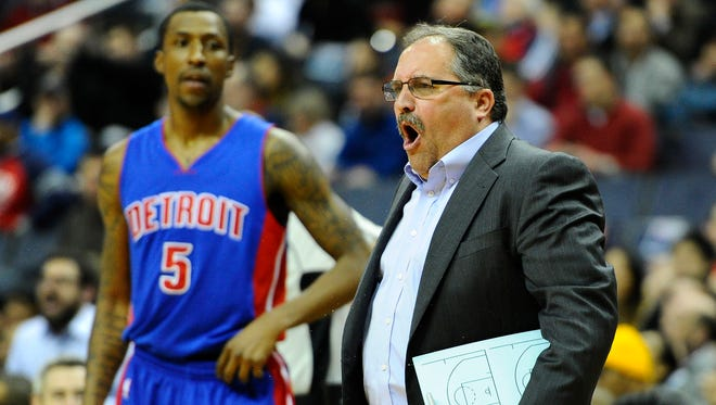 Mar 14, 2016; Washington, DC, USA; Detroit Pistons head coach Stan Van Gundy (R) yells from the sidelines against the Washington Wizards during the first half at Verizon Center.