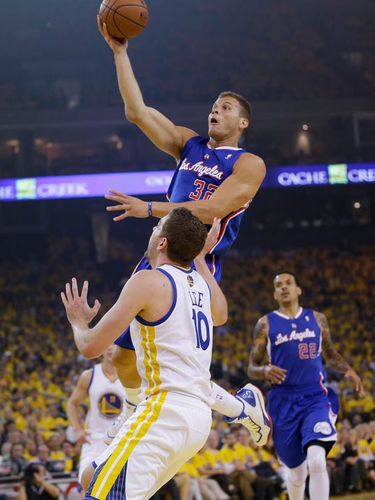 Los Angeles Clippers' Blake Griffin, shoots over Golden State Warriors' David Lee (10) during the first half in Game 3 of an opening-round NBA basketball playoff series, Thursday, April 24, 2014, in Oakland, Calif. (AP Photo/Marcio Jose Sanchez)