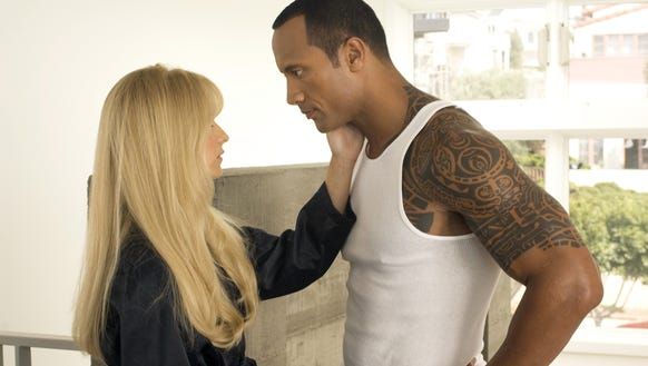 "Sarah Michelle Gellar (left) and Dwayne Johnson star in the pre-apocalyptic satire ""Southland Tales."""