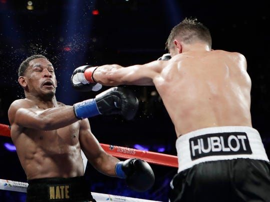 Gennady Golovkin, of Kazakhstan, right, throws a left at Daniel Jacobs during the 11th round of a middleweight boxing match early Sunday, March 19, 2017, in New York. Golovkin won the fight. (AP Photo/Frank Franklin II)