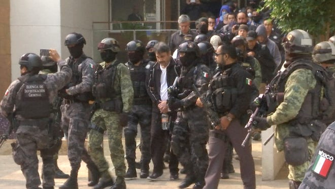 """This frame grab from video shows Damaso Lopez, known by the nickname """"El Licenciado,"""" escorted by police after his capture at an upscale apartment building on a major boulevard in Mexico City, Tuesday, May 2, 2017. Mexican prosecutors said they captured Lopez, one of the Sinaloa cartel leaders who launched a struggle for control of the gang following the re-arrest of Joaquin """"El Chapo"""" Guzman. Lopez was long considered Guzman's right-hand man and helped him escape from a Mexican prison in 2001."""