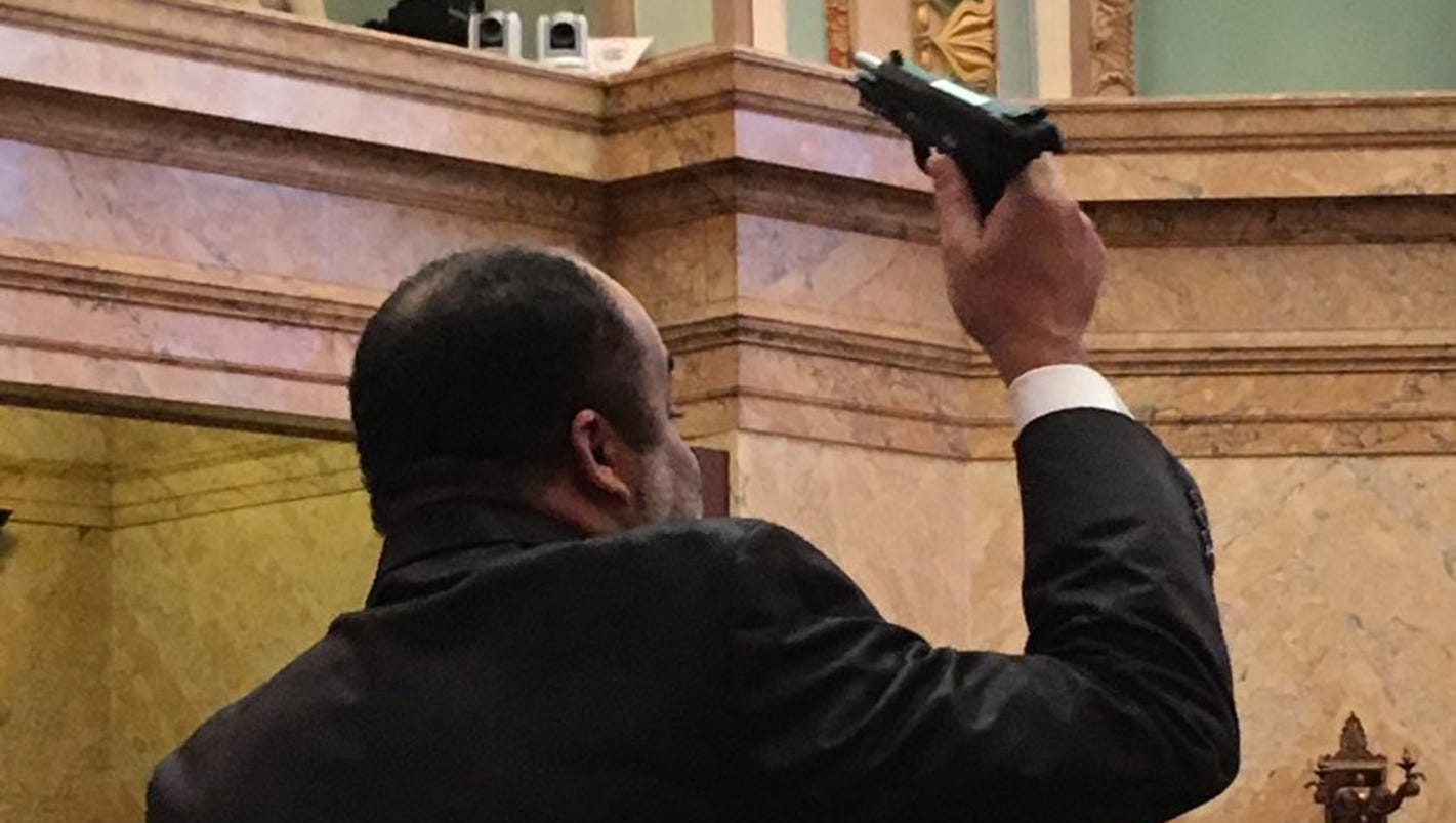 Mississippi lawmaker displays gun on House floor to protest gun bill