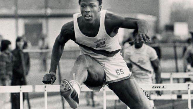 Jerry Holloway runs the hurdles during the 1974 season. Holloway starred in both track and football at East High School and Western Illinois. His reluctance to give up track is why he didn't play for a bigger college, but he was named one of the Rockford area's 25 greatest football players.