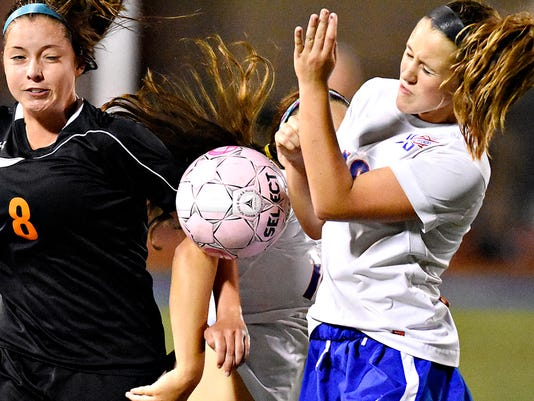 Central York's Payton Salsgiver, left, collides with Spring Grove's Bryn Sporer, center, and Izzy Dukehart, right, during girls' soccer action in Spring Grove, Pa. on Thursday, Sept. 24, 2015. Central York would win the game 1-0. Dawn J. Sagert - dsagert@yorkdispatch.com