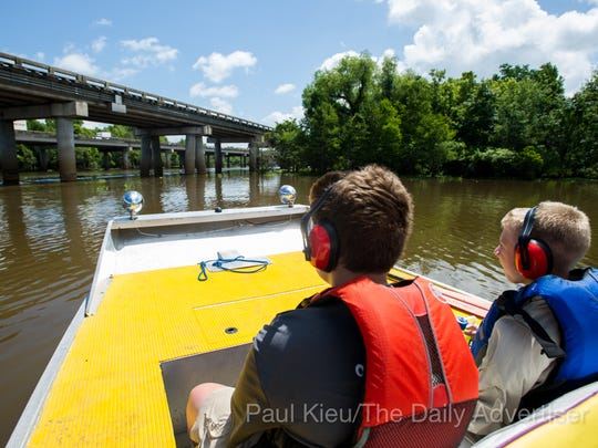 Members of Boy Scout Troop 383 of Evansville, Indiana, approach the Atchafalaya Basin Bridge while riding in an airboat in the basin near Henderson, LA, Tuesday, July 1, 2014. The troop is currently participating in the Evangline Area Council's Swamp Base kayak trek which takes them on a sixty-mile path through the basin.    Photo by Paul Kieu, The Advertiser